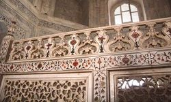 The frieze of the railing inside the Taj Mahal